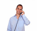 Smiling latin man speaking on phone portrait of a while is looking at you against white background Stock Photo