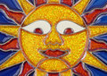 Smiling leaded glass sun face Stock Photo
