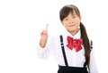 Smiling little asian schoolgirl Stock Image