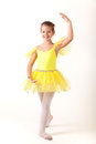 Smiling little ballerina exercising Stock Photo