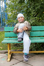 Smiling little boy on bench Royalty Free Stock Image
