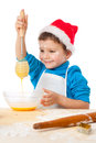 Smiling little boy with egg-beater Stock Images