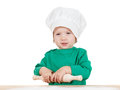 Smiling little boy kneading dough for the cookies Royalty Free Stock Photo