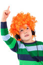 Smiling little boy  listening to music in headphon Royalty Free Stock Photos