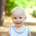 Smiling little boy in the park Royalty Free Stock Photos