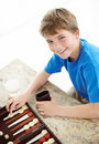 Smiling little boy playing backgammon game Stock Images