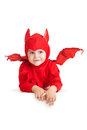 Smiling little boy in red devil costume over white background Royalty Free Stock Photos