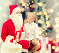 Smiling little boy with santa claus and gifts Royalty Free Stock Photo