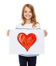 Smiling little child holding picture of heart Royalty Free Stock Photo