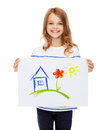Smiling little child holding picture of house creation art family happiness and painting concept Stock Photo
