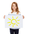 Smiling little child holding picture of sun creation art family happiness and painting concept Stock Photography