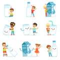 Smiling little children playing and dancing with large boxes, mugs and bottles of milk, set for label design. Colorful