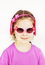 Smiling little cute girl wearing pink sunglasses against white background Royalty Free Stock Images