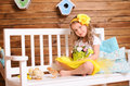 Smiling little girl and alive chickens on bench Royalty Free Stock Photo