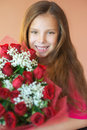 Smiling little girl with bouquet Royalty Free Stock Photos