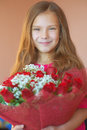 Smiling little girl with bouquet beautiful big of roses on birthday Stock Photo