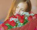Smiling little girl with bouquet of roses beautiful big on birthday Stock Photos
