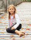 Smiling little girl on bridge Royalty Free Stock Photo