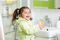 Smiling little girl brushing teeth in bath Royalty Free Stock Photo