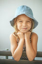 Smiling little girl in cap beautiful Stock Photos