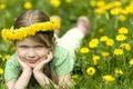 Smiling little girl in Dandelions Stock Photo