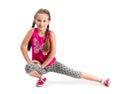 Smiling little girl doing exercise