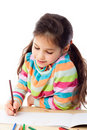 Smiling little girl draw with crayons Stock Photos