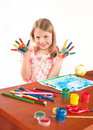 Smiling little girl drawing picture Stock Images