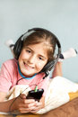 Smiling little girl enjoys music happiness Stock Photos
