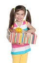 Smiling little girl with a gift box on the white background Stock Photography