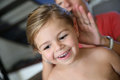 Smiling little girl having her hair done Royalty Free Stock Photo