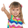Smiling little girl with her thumb up Stock Photo