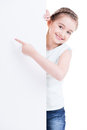 Smiling little girl holding empty white banner isolated on Royalty Free Stock Photo