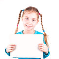 Smiling little girl holding empty white card you sample text isolated white Stock Images