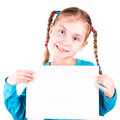Smiling little girl holding empty white card you sample text isolated white Royalty Free Stock Images