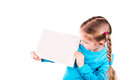 Smiling little girl holding empty white card you sample text isolated white Stock Photo