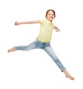 Smiling little girl jumping Royalty Free Stock Photo