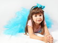 Smiling little girl laying cute studio shot Royalty Free Stock Image