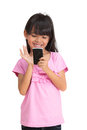 Smiling little girl with mobile phone Stock Photos