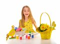 Smiling little girl painting Easter eggs Royalty Free Stock Photography