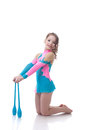 Smiling little girl posing with gymnastic mace isolated on white Stock Photo