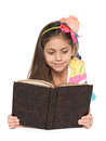 Smiling little girl reads an old book Royalty Free Stock Photo