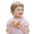 Smiling little girl with a seashell playing on white background Stock Photography