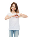 Smiling little girl showing heart with hands Royalty Free Stock Photo