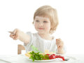 Smiling little girl showing her table knife Stock Photography