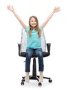 Smiling little girl sitting in big office chair education celebration and happy people concept with hands up Stock Photos