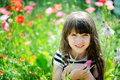 Smiling little girl sitting on poppy field Royalty Free Stock Photo