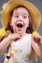 Smiling little girl in a straw hat Royalty Free Stock Photos