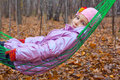 Smiling little girl swinging hammock autumn forest Stock Photography