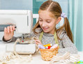 Smiling little girl at the table with sewing Royalty Free Stock Photo